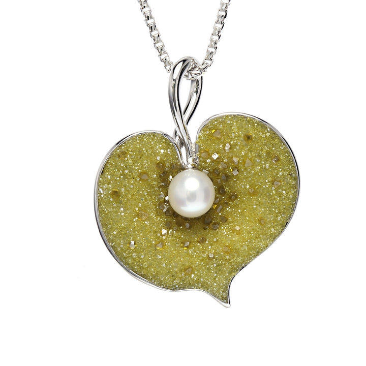 Heart-shaped pearl and yellow diamond pendant by Chi Galatea