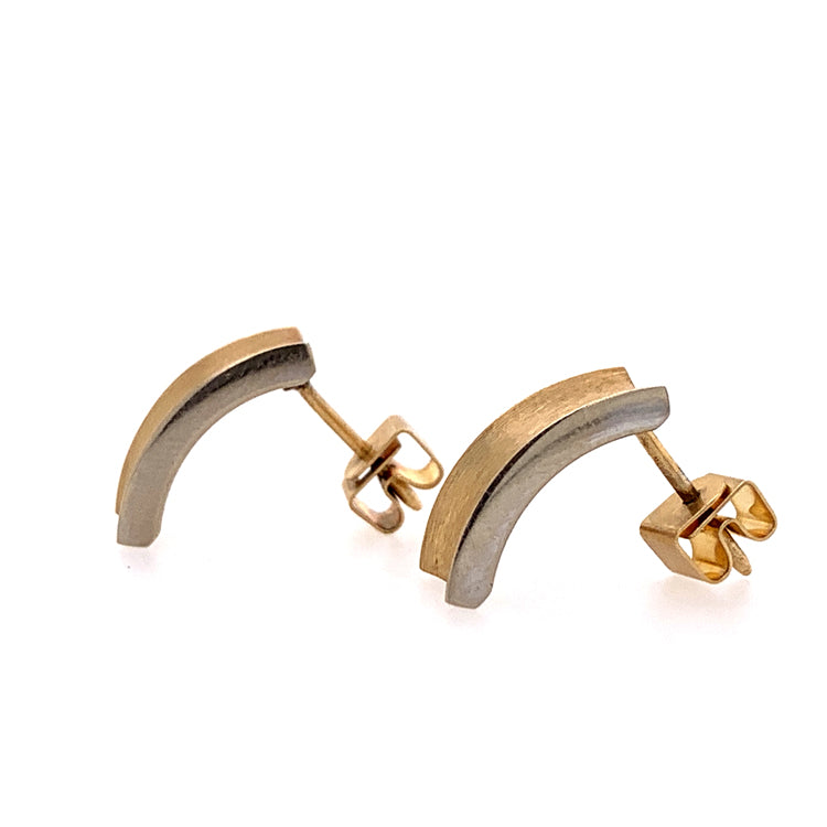White and yellow gold stud earrings with diamond accents, yellow gold backings
