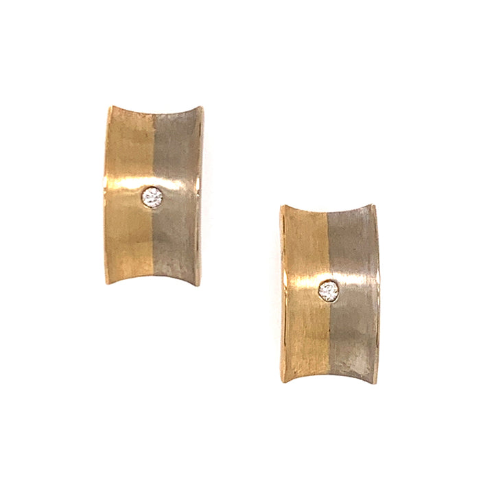 White and yellow gold stud earrings with diamond accents