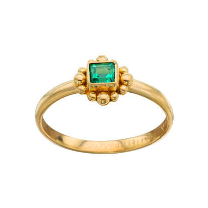 Petite emerald ring with granulated halo by Steven Battelle