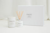Darling Northumberland natural wax candle and diffuser next to white luxury gift box