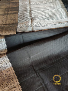 Captivating black kanjeevaram with silver thread work on the pallu