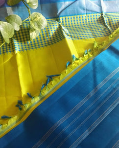 Chartreuse green Kanjeevaram with deep blue border and a beautiful checks border lining the saree
