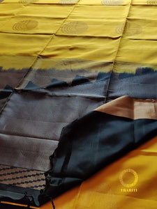 Yellow silk with black pallu and gold and silver thread work