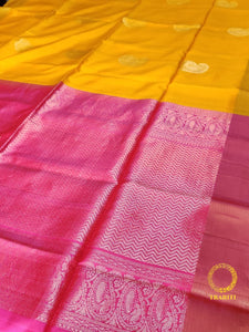 Bright yellow soft silk with pink heavy gold pallu