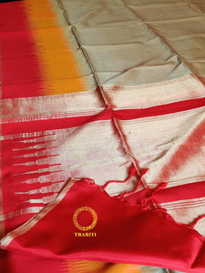 Hazelwood beige with orange and red border and red gold thread work on the pallu