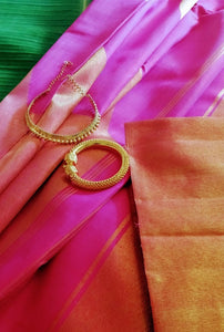 Elegant ruby pink kanjeevaram with stunning  gold border