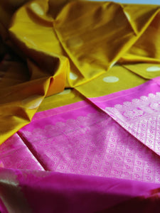 Traditional mustard kanjeevaram with magenta gold pallu