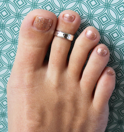 5mm Hammered Sterling Adjustable Toe Ring shown on a foot