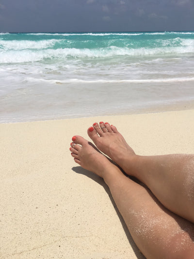 On vacation at the beach wearing a 1mm 14k gold fitted toe ring