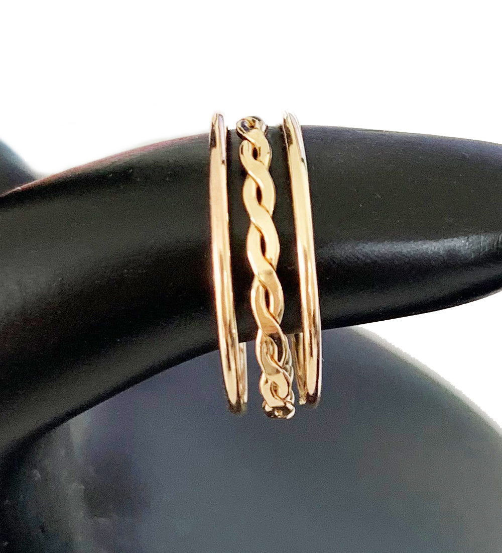 Skinny Band and Braid Stack Toe Rings shown in gold fill on a model's finger