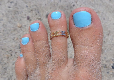 Butterfly Sterling & 14K Gold Toe Ring shown on a pedicured toe