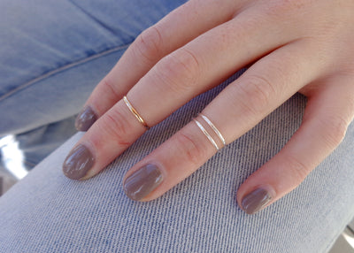 1mm Simple Toe Ring shown worn as a midi finger ring