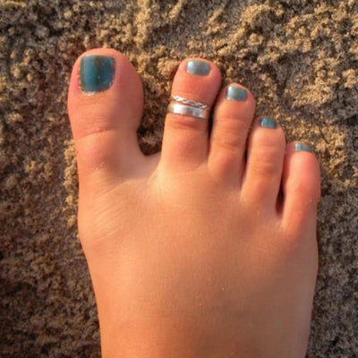 3mm Flat Sterling Toe Ring shown on a foot in the sand