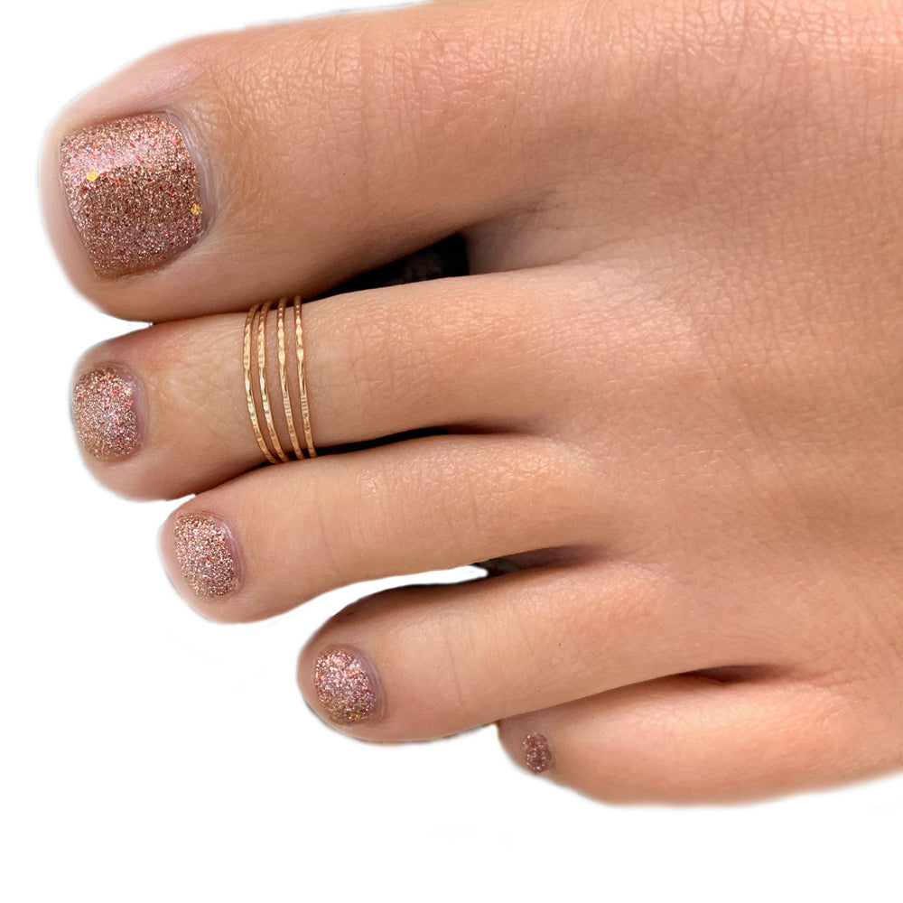 Four Strand Gold Adjustable Toe ring shown on a toe