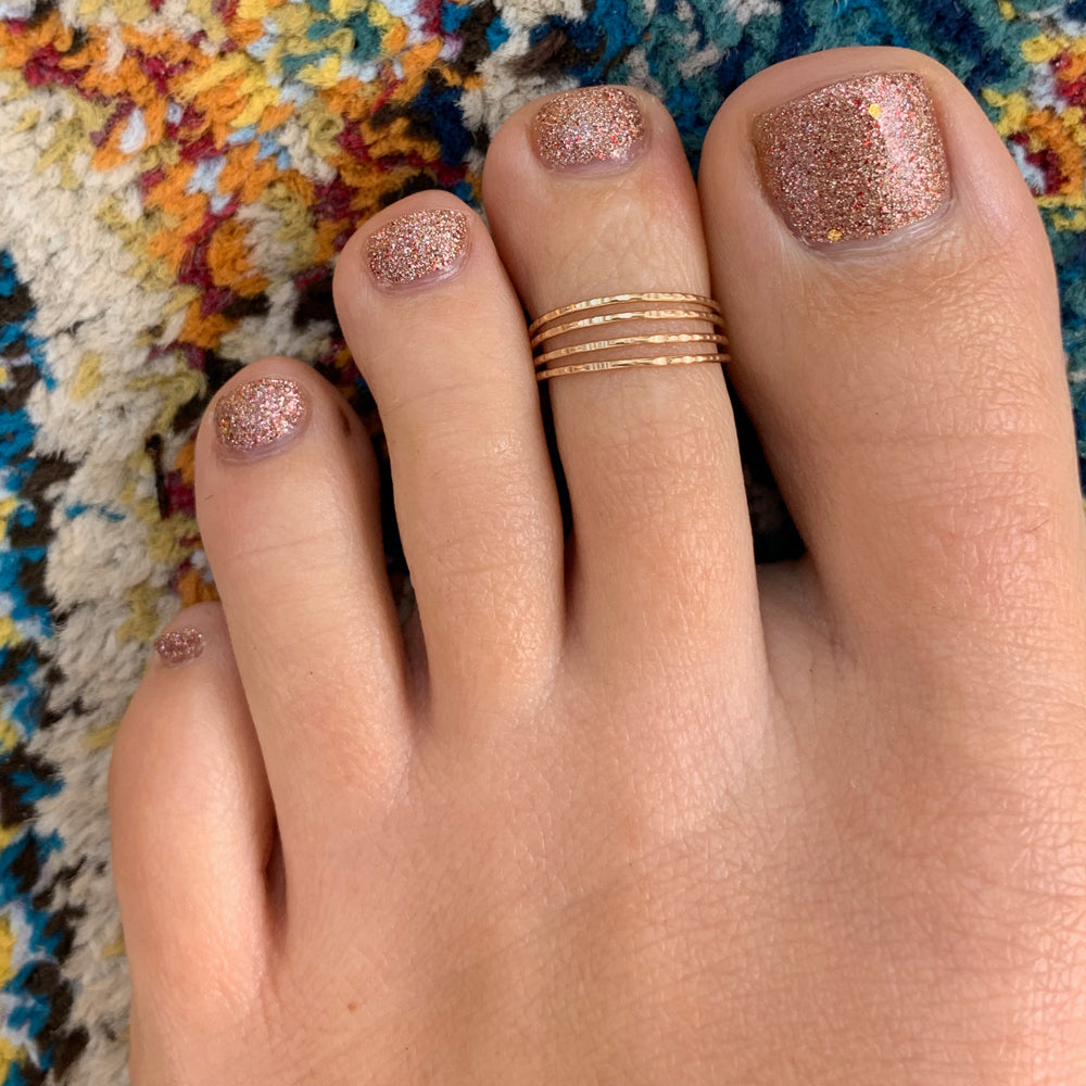Four Strand Gold Adjustable Toe ring shown on a foot