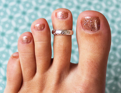 Garden Party Gold Fill Adjustable Toe Ring shown on a toe
