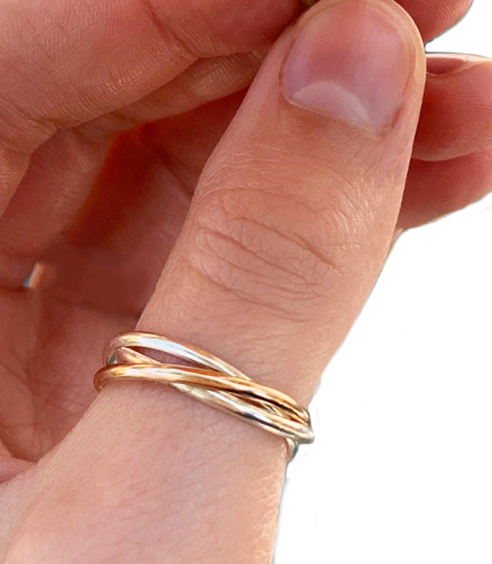 Rolling Interlock Sterling and Gold Fill Thumb Ring shown worn on a thumb