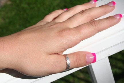 Braid Brawny Sterling Thumb Ring shown on a woman's hand