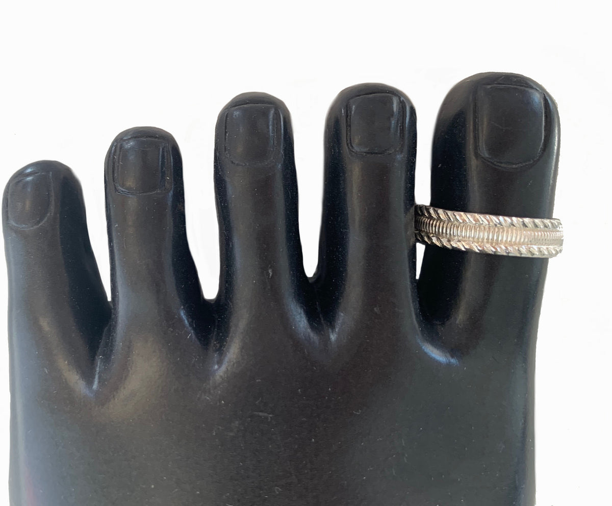 Tiki Sterling Big Toe Ring, shown on a model's toe