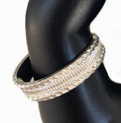 Tiki Sterling Thumb Ring, displayed on a model