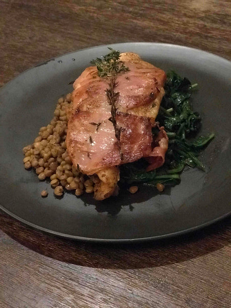 Prosciutto wrapped Jerk Fish with Spinach and Lentils