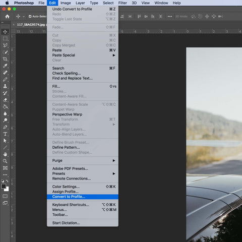Selecting convert to profile in Photoshop grey menu bar.