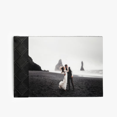 Black checkered leather photo album with a picture of a woman kissing a man.