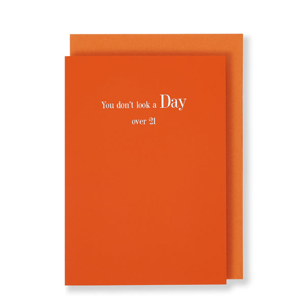 You Dont Look A Day Over 21 Greeting Card in Orange, Front
