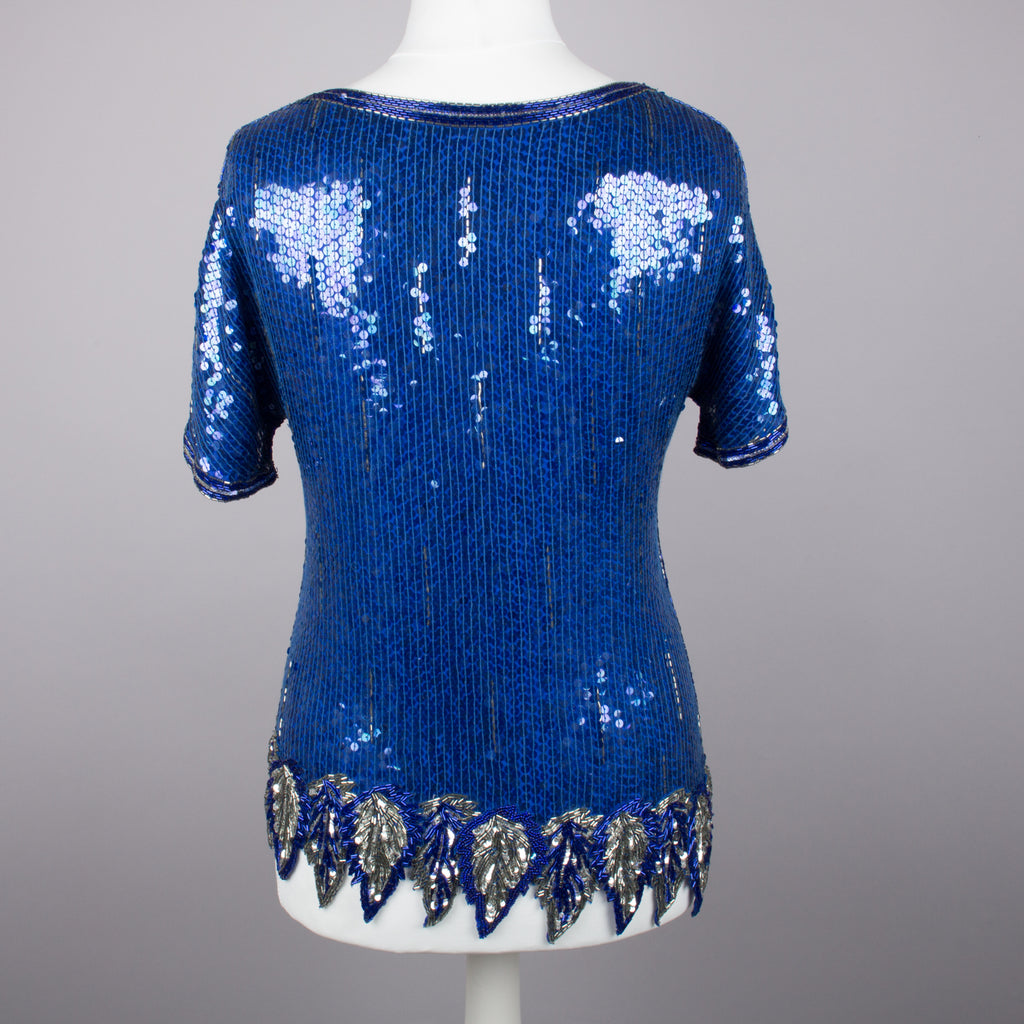 1980s blue and silver V neck sparkly vintage top