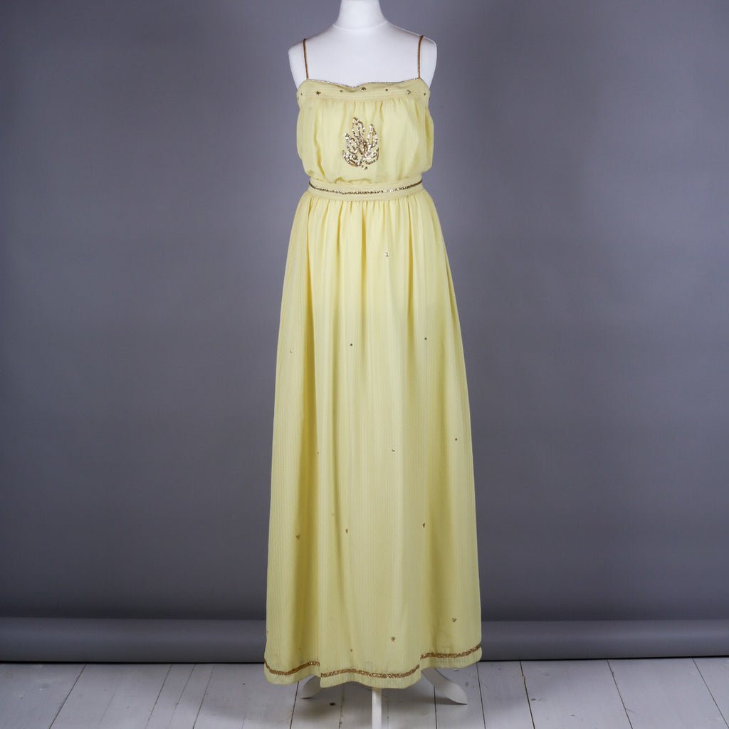 1970s yellow and gold goddess dress