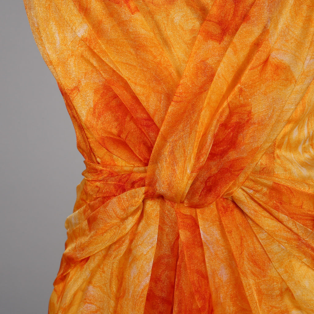 1950s orange cocktail dress by Madison Avenue