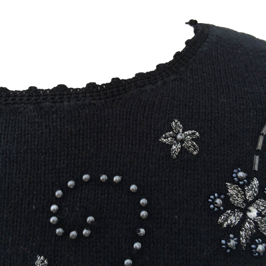 Black and silver snowflake design sweater