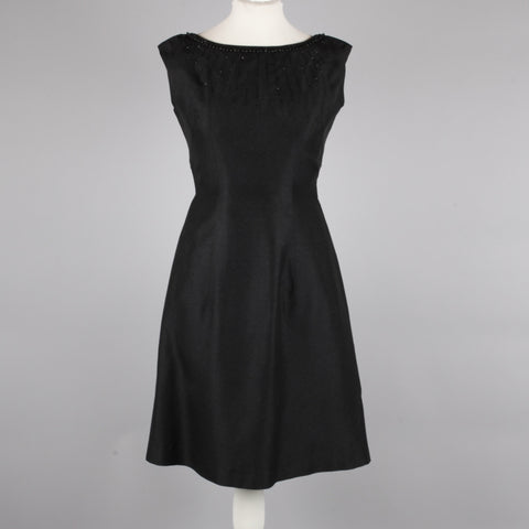 1960s chic black vintage cocktail dress