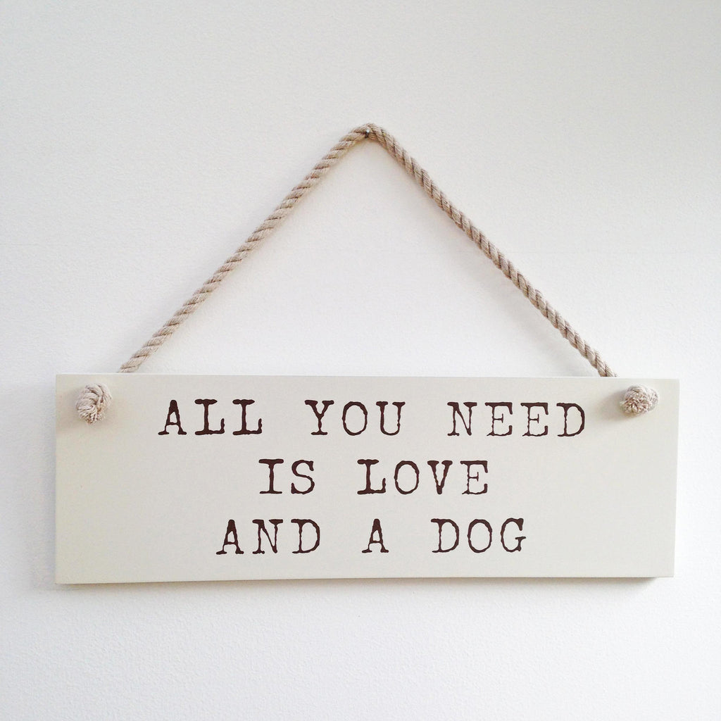 All You Need is Love and a Dog wooden wall sign