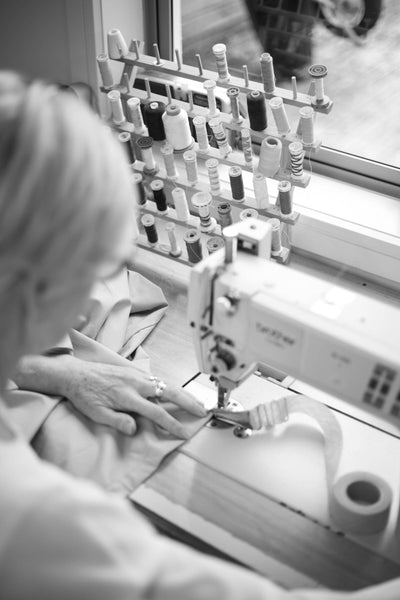 Photo of Woman working on Sewing Machine