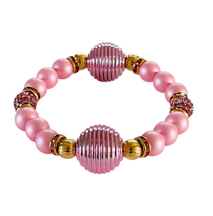SPIRAL AND PEARL BANGLE IN PINK