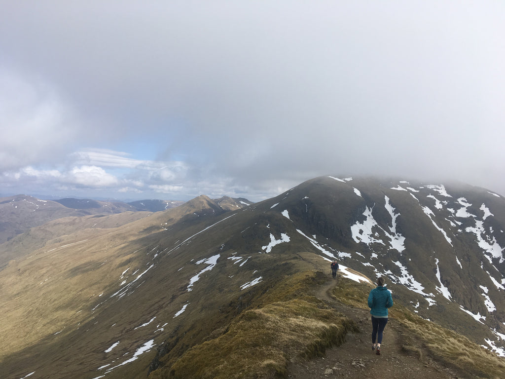 Jess on her way up to Ben Lawers lost somewhere in the cloud. Photo: Erik Schulte