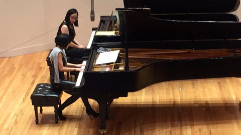 Sisi Liu performing at a masterclass with Yuja Wang