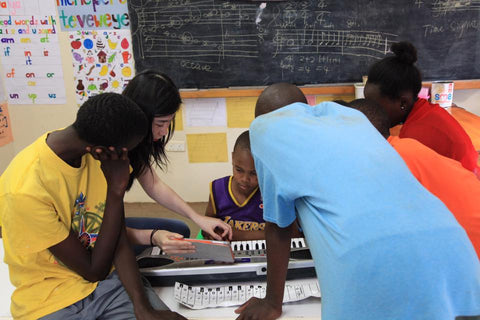 Yifan Shao teaching music and piano at Rehema home orphanage