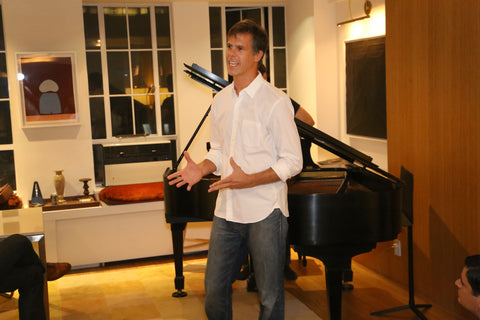 Pianist Andy Luse is giving a speech at Park Avenue Pianos