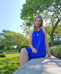 Brandy Searcy sitting on a concrete bench underneath a green leafy tree in Edmonton, IL