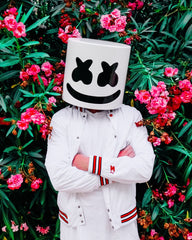 Marshmello standing next to blooming fuschia oleander