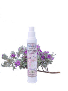 Abigail's Serum by Return to Eden Cosmetics in a 1 oz airless bottle with light pink label against a white background with a sprig of blooming silver sage behind the bottle