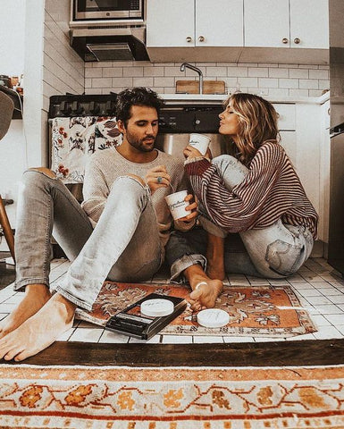 couple on floor with ice cream for date night at home
