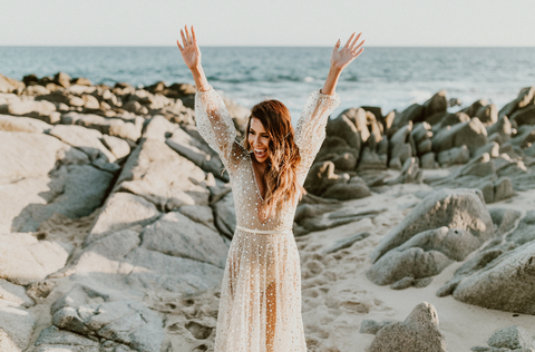 bride in shimmering gold dress at beach