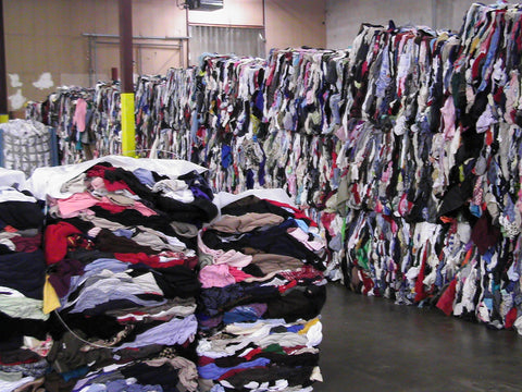 piles of clothing demonstrating waste in fashion industry