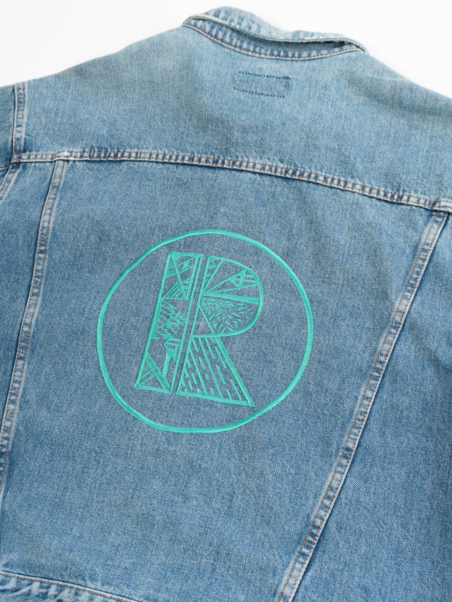 Light Blue Denim Jacket with Large Turquoise Rhetorik Logo on Back - Size XXL