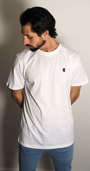 Man model wearing white Rhetorik T-shirt with mini-R embroidered