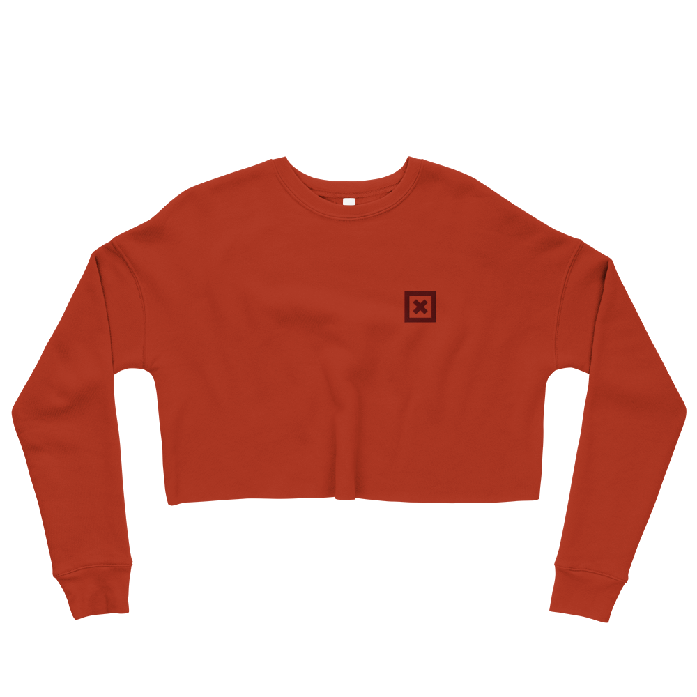"Flat lay of Red Xoo Life crop sweatshirt with small, red embroidered ""x"" on left chest"